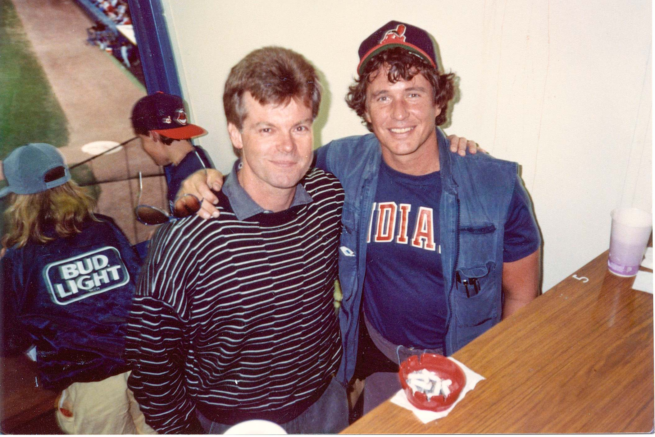 David S. Ward and Tom Berenger sitting in press box of Milaukee Stadium during filming of the movie Major League