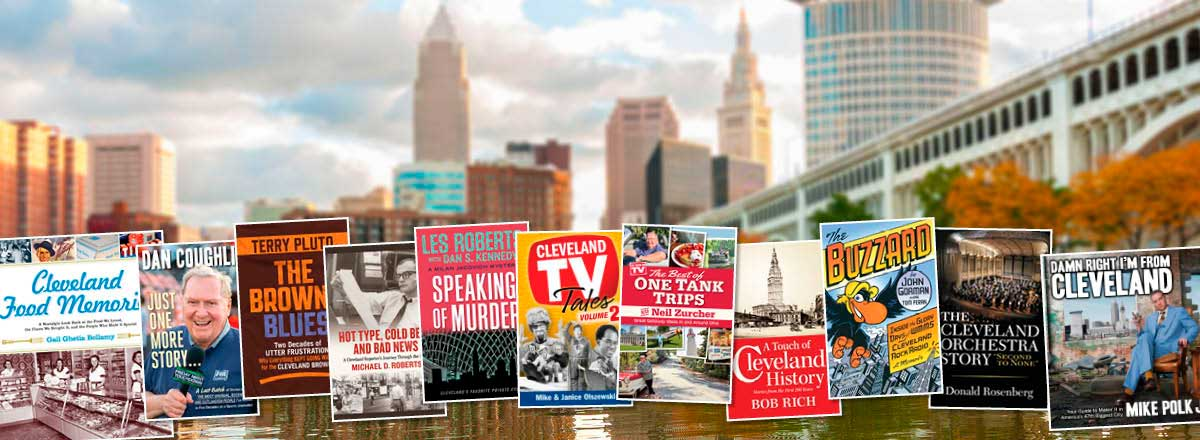 Books about Cleveland in front of a photo of the Cleveland skyline