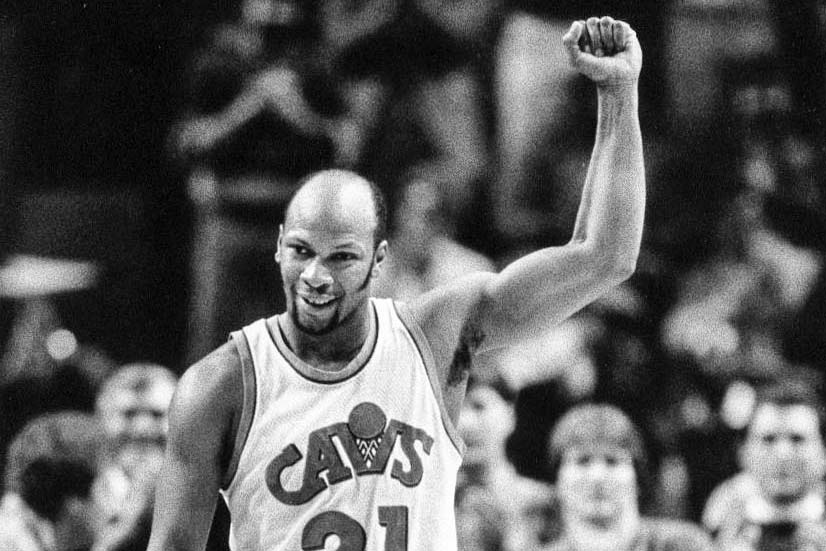 World B. Free, wearing Cavs uniform, raises his left arm and smiles