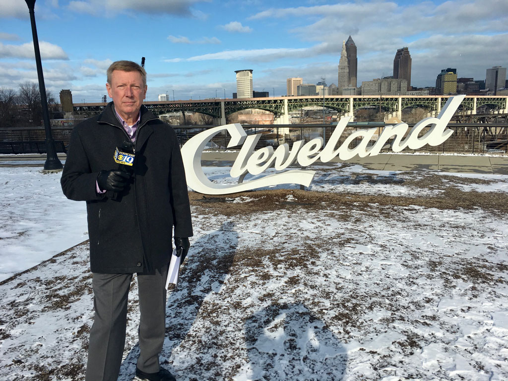 Paul Orlousky standing in front of the Cleveland sign at Edgewater Park.